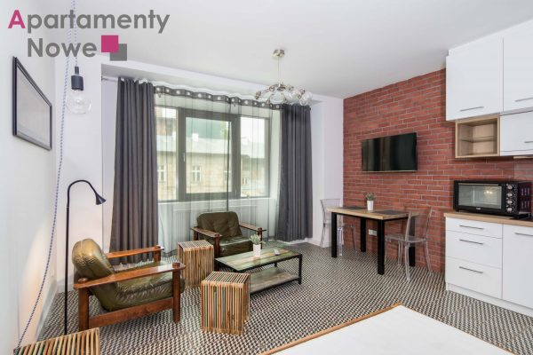 """A functional, stylish studio-apartment of 32 sqm in the prestigious investment """"Wawrzyńca 19″"""